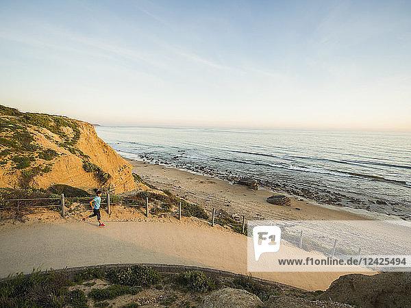 USA  California  Newport Beach  Woman running along footpath