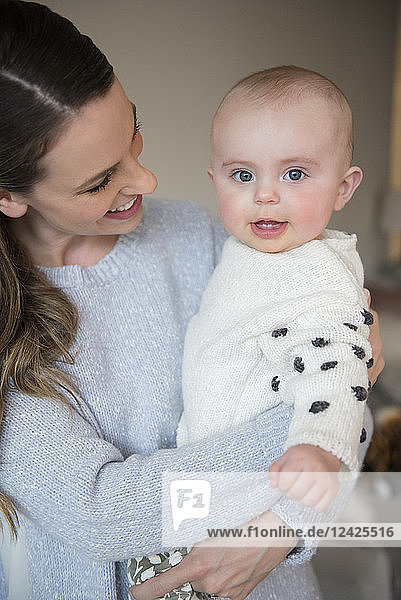 Mother holding baby (18-23 months) in arms
