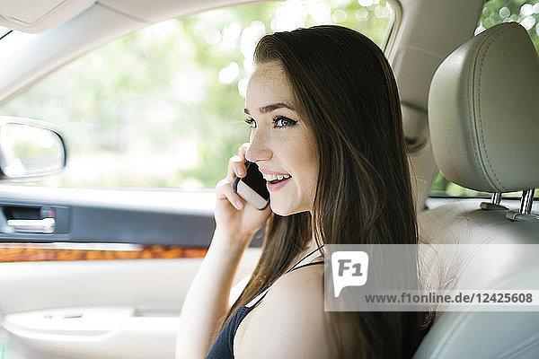 Young woman on phone in car