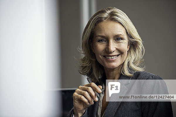 Close-up of businesswoman smiling