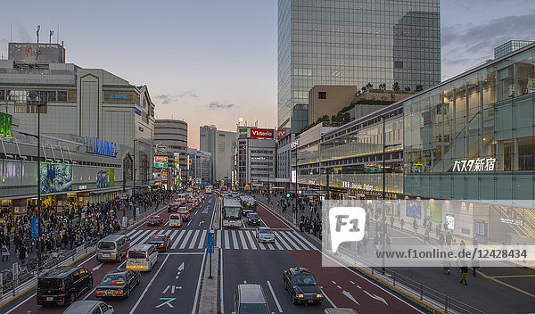 Street scene with traffic and pedestrians in the Shinjuku district of Tokyo  Japan
