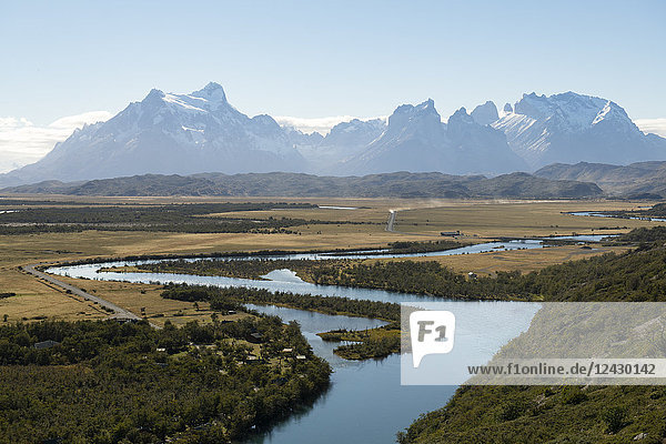 Majestic natural scenery with Rio Serrano river and mountain range in Torres del Paine National Park  Magallanes Region  Chile