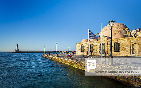 Hassan Pasha Mosque and The Venetian era harbour and the lighthouse at the port of Chania  Crete  Greek Islands  Greece  Europe