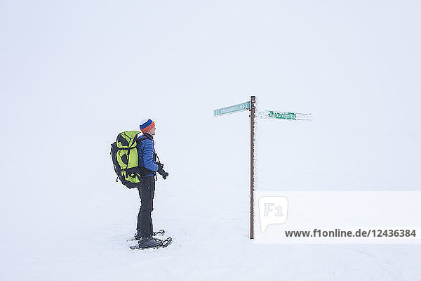 Photographer on snowshoes  Pallas-Yllastunturi National Park  Muonio  Lapland  Finland  Europe