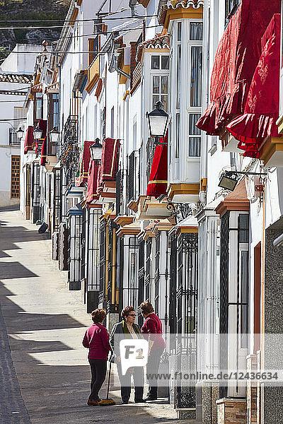 Semana Santa (Holy Week) decoration and three women wearing same colours  Olvera  Andalucia  Spain  Europe