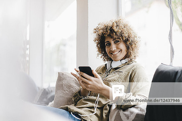 Young woman working in coworking space  using at smartphone