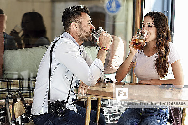 Couple having a drink at an outdoor bar in the city