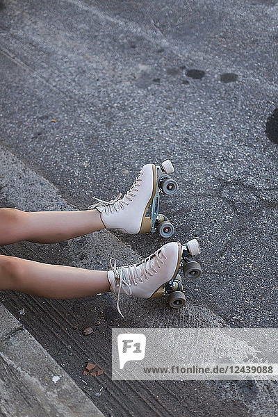 Young woman with roller skates on lane  partial view