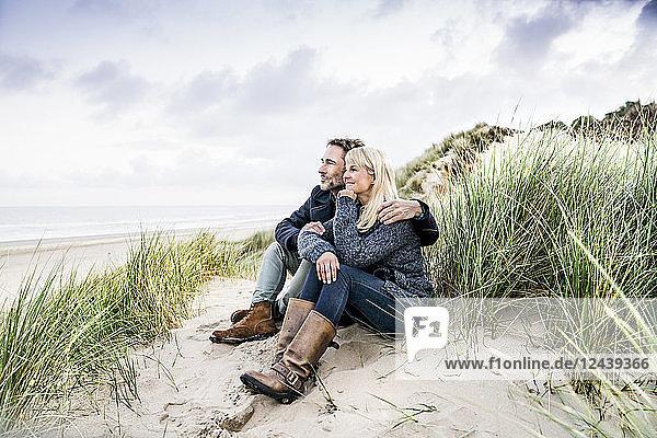 Couple sitting in dunes