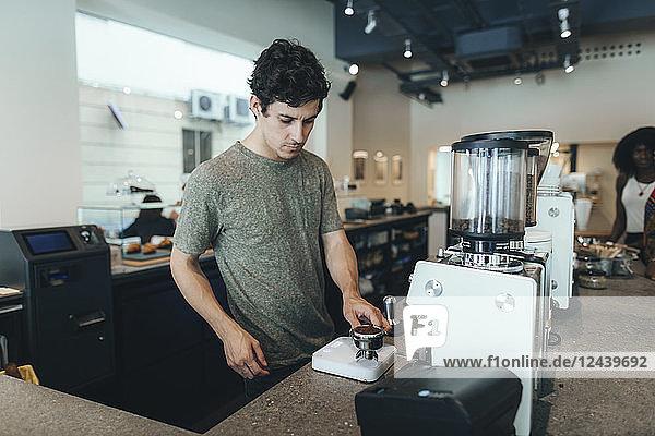 Barista preparing coffee in a coffee bar