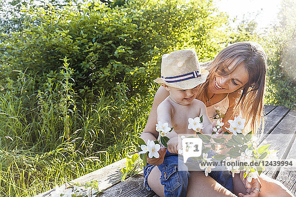 Mother and baby boy having fun together on terrace