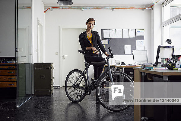 Businesswoman with bicycle in her start-up company