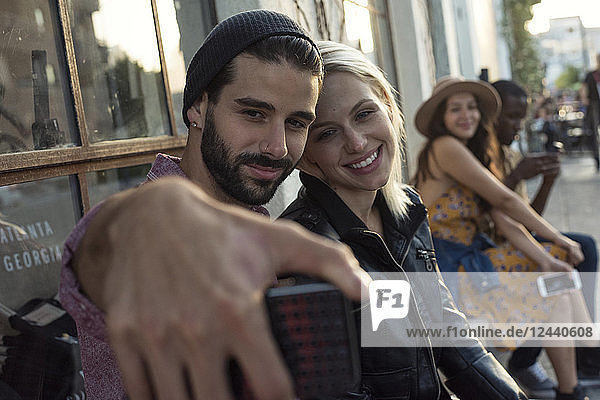 Young man with girlfriend taking a selfie
