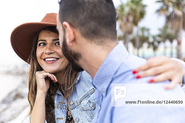 Spain  Barcelona  smiling beautiful woman looking at her boyfriend