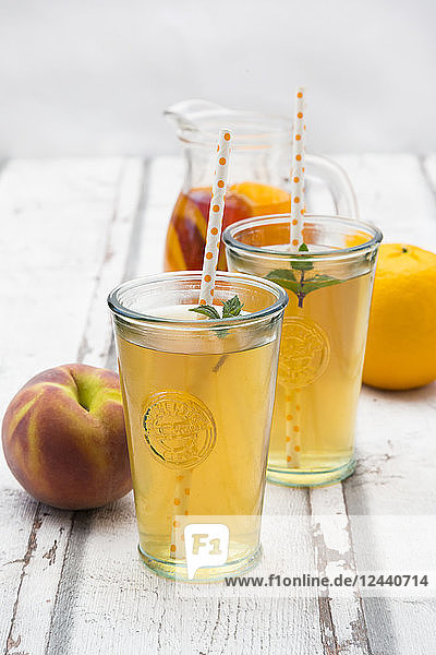 Two glasses of peach orange ice tea