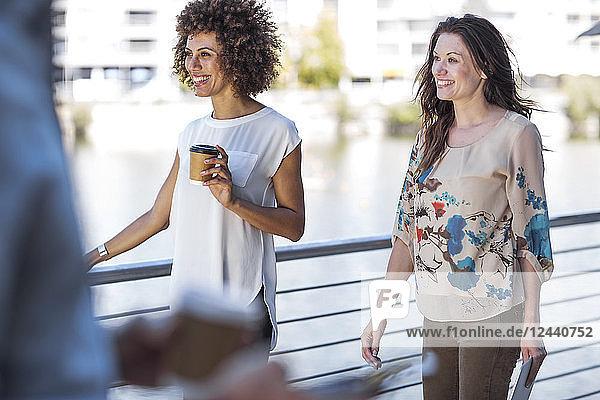Two businesswomen taking a break  outdoors