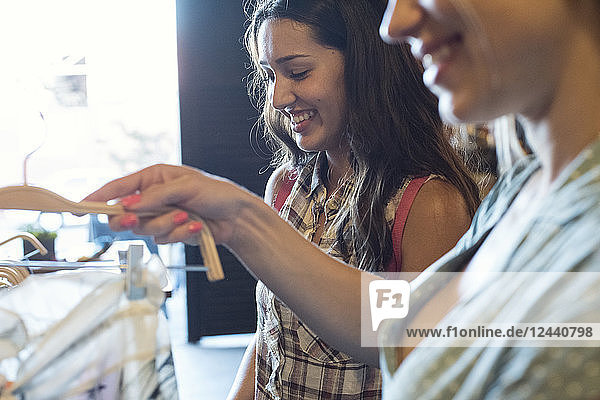 Two young women shopping for new clothes together