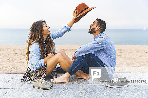 Spain  Barcelona  couple having fun together on the beach