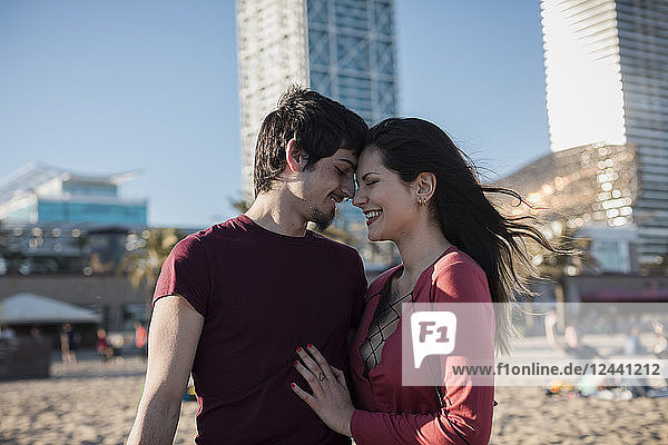 Happy affectionate young couple on the beach