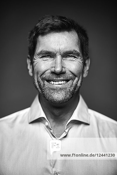 Portrait of smiling man  black and white