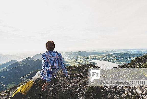 Austria  Salzkammergut  Hiker taking a break  looking over the Alps