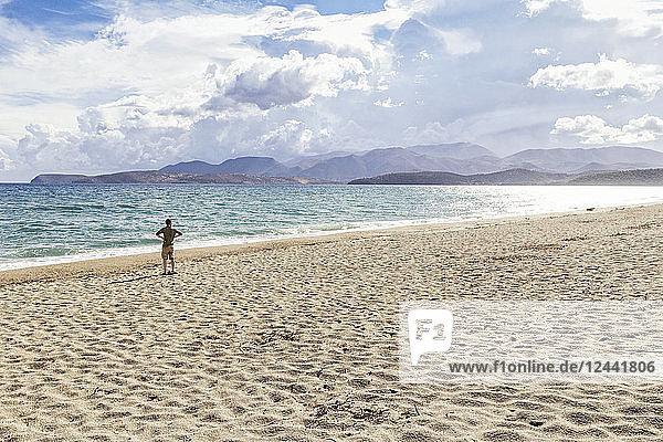 Greece  Peloponnese  Mani peninsula  man at the beach of Mavrovouni