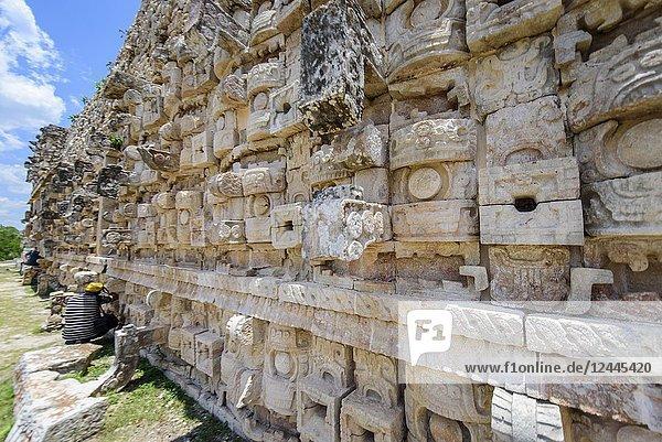 Photographer in the ruins at Kabah  Yucatan Peninsula  Mexico.
