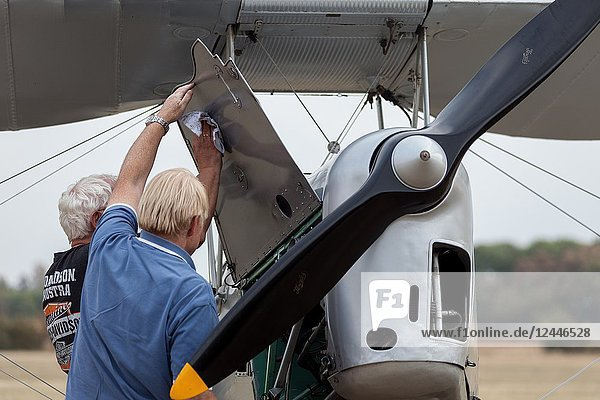 'Flugtage Soest Bad Sassendorf' 2018. Air strip Bad Sassendorf  Soester Börde  Haar  Germany. Two men (owner and pilot) carefully cleaning the old Tiger moth after their fly-in.