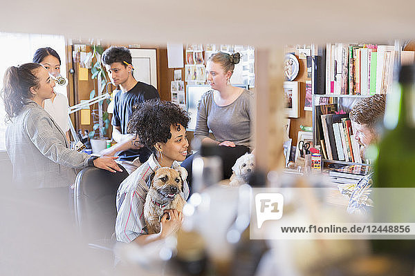 Creative designers with dogs in office