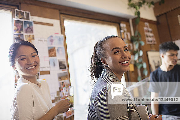 Portrait laughing creative businesswomen in office