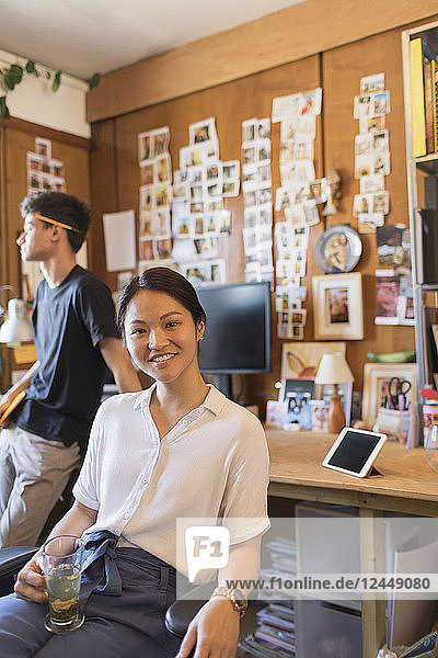 Portrait smiling  confident creative businesswoman drinking tea in office