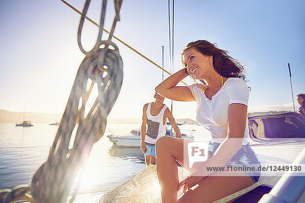 Happy young woman relaxing on sunny boat Happy young woman relaxing on sunny boat