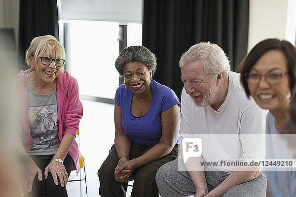 Smiling active seniors talking