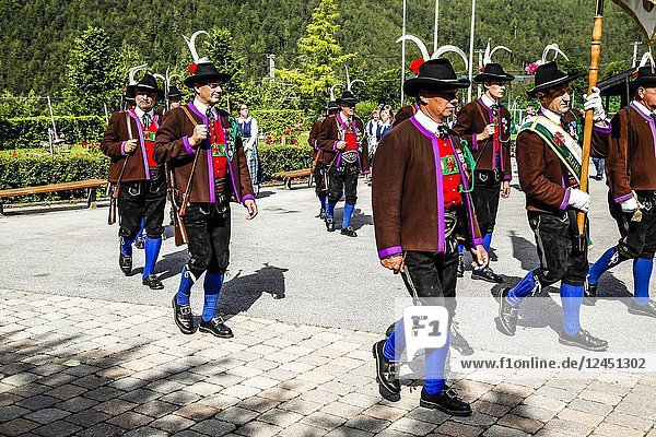 Men of the Tyrolean Militia march out of the village square on Patronage day in Reith bei Seefeld  Austria.