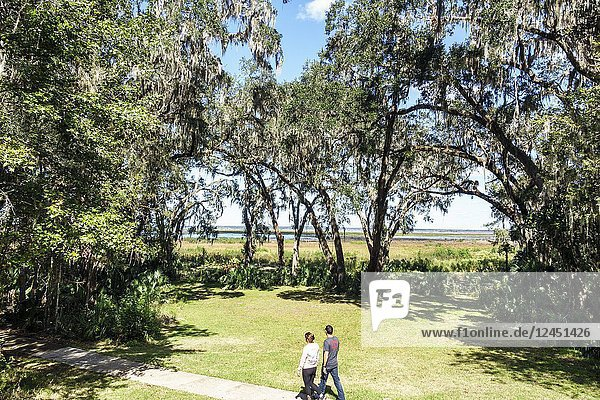 Florida  Gainesville  Micanopy  Paynes Prairie Ecopassage Nature Preserve State Park  National Natural Landmark  environmental conservation  Wacahoota Trail  hiking  walking  man  woman  couple