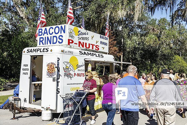 Florida  Micanopy  Fall Harvest Festival  annual small town community event  booths stalls vendors buying selling  food truck trailer  bacon rinds  roasted peanuts  man  woman  senior  families