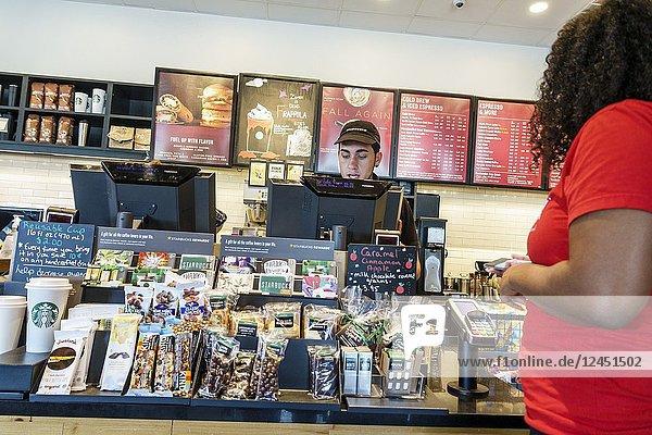 Florida  Ocala  Starbucks Coffee  interior inside  cafe  coffeehouse  counter  cashier  ordering  snack food display  man  woman  barista