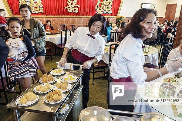 Florida  Orlando  Chinatown  Lam's Garden Chinese  restaurant  dim sum  Asian  woman  girl  teen  waitress  pushing cart  server  interior
