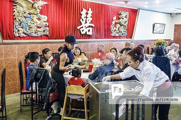 Florida  Orlando  Chinatown  Lam's Garden Chinese  restaurant  dim sum  ethnic  dining  large family  table  Asian  man  woman  girl  boy  child  high chair  waitress  cart  server  interior