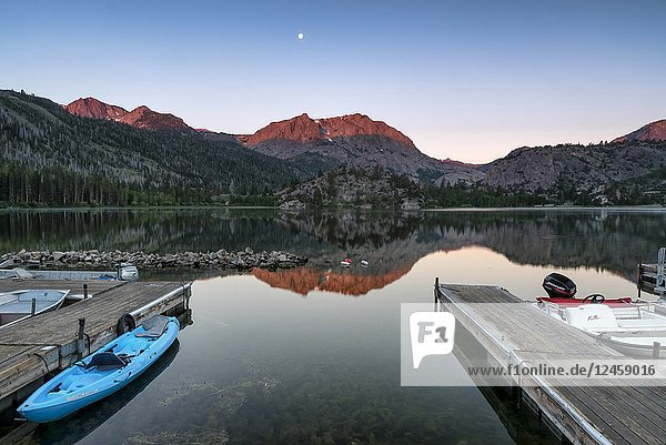 Alpenglow sunrise on Caron Peak and reflections on beautiful Gull Lake  in the Eastern Sierra Mountains  California  USA.