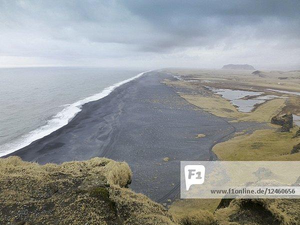 Black beach in Dyrhoaley Iceland.