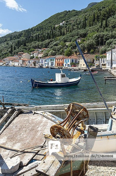 Old boats and colourful old houses in the town of Vathy on the island of Ithaca  Ionian Sea  Greece.