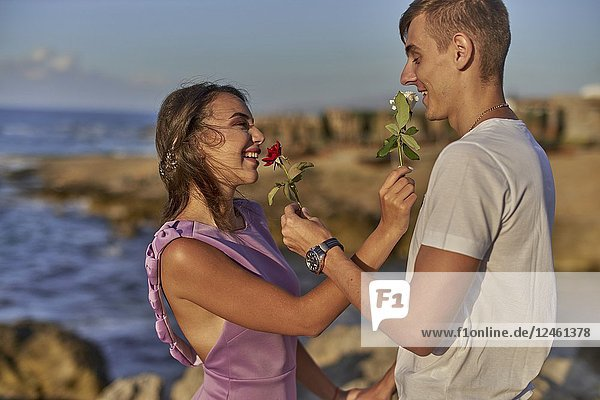 Couple with roses at beach. Love  relationship  romantic.