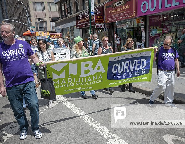 Makers of rolling papers join advocates for the legalization of marijuana in New York on Saturday  May 5  2018 at the annual NYC Cannabis Parade. The march included a wide range of demographics from millennials to old-time hippies. The participants in the parade are calling for the legalization of marijuana for medical treatment and for recreational uses. (© Richard B. Levine).