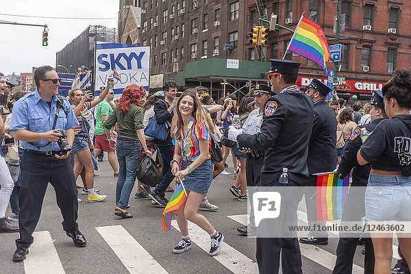 Thousands of marchers and spectators turn out for the annual Lesbian  Gay  Bisexual Transgender and Queer (LGBTQ) Pride Parade on Fifth Avenue in New York on Sunday  June 24  2018. This year the parade had a new route  starting on Seventh Avenue and then proceeding east eventually going up Fifth Avenue. The change is in anticipations of the WorldPride celebration to be held in New York next year on the 50th anniversary of the Stonewall uprising where millions of people are expected to converge on New York. (© Richard B. Levine).
