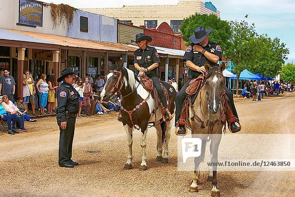 Two Arizona Rangers on horseback ride along E Allen St at the annual Doc Holiday event in Tombstone.