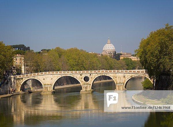 Rome  Italy. Sisto bridge (Ponte Sisto) crossing the Tiber River. Dome of St. Peterâ.s in background.
