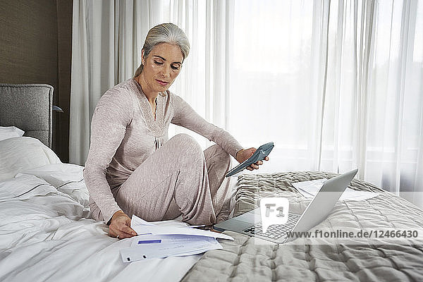 Mature woman working at home.