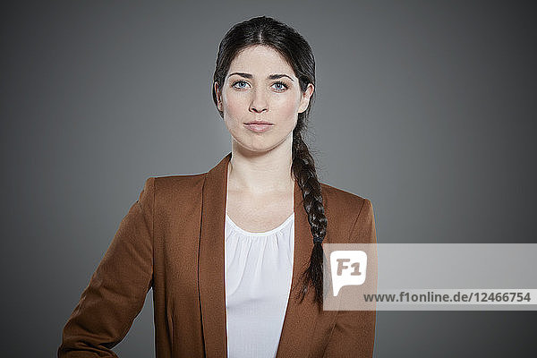 Portrait of young woman with braided hair.