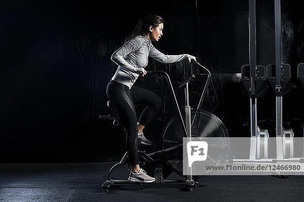 Woman using exercise machine